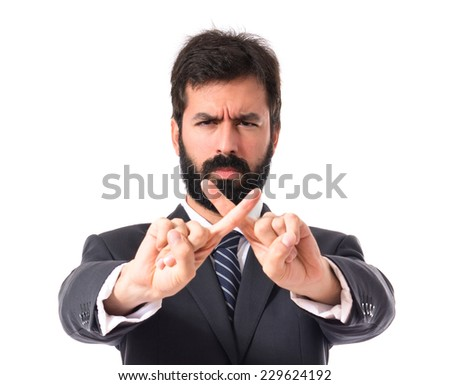 Businessman doing NO gesture over white background - stock photo