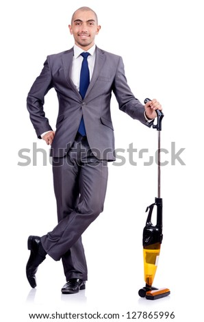 Businessman doing vacuum cleaning on white - stock photo