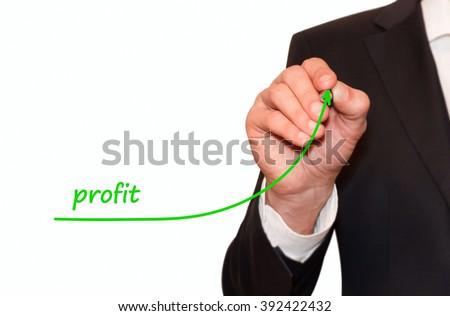 Businessman draw plan to increase Profit - stock photo