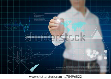 businessman draw technology symbols coming from hand - stock photo