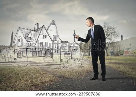 Businessman drawing  - stock photo