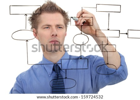 Businessman drawing a chart on the screen - stock photo