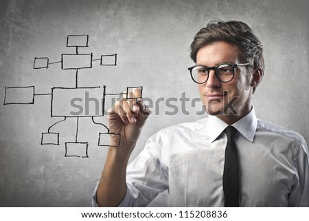 Businessman drawing a diagram