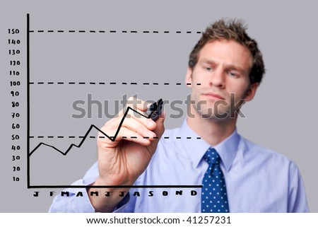 Businessman drawing a graph on a glass screen, add your own text. The background is a uniform color all over so you can increase the copy space easily. Focus is on his hand and pen. - stock photo