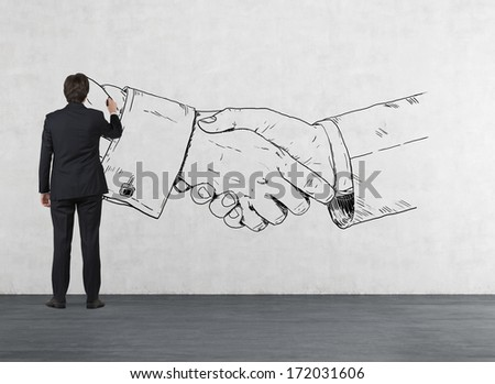 Businessman drawing a handshake - stock photo