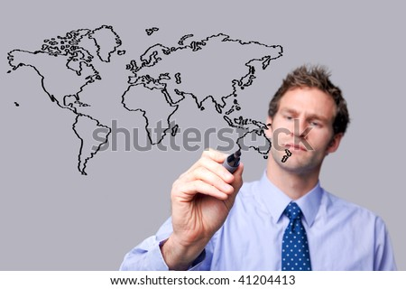 Businessman drawing a map of the world on a glass screen. The background is a uniform color all over so you can increase the copy space easily. Focus is on his hand, pen and sketch.