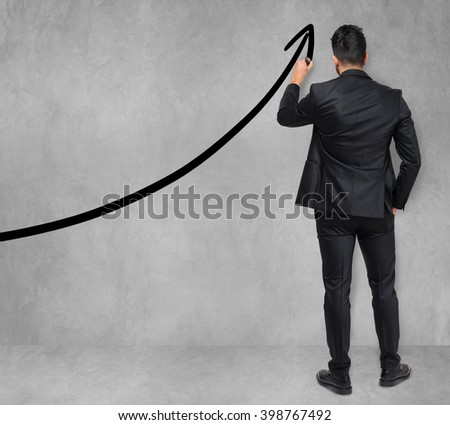 Businessman drawing a rising arrow, business growth concept - stock photo