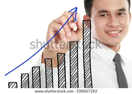 Businessman drawing a rising diagram, representing business growth. - stock photo