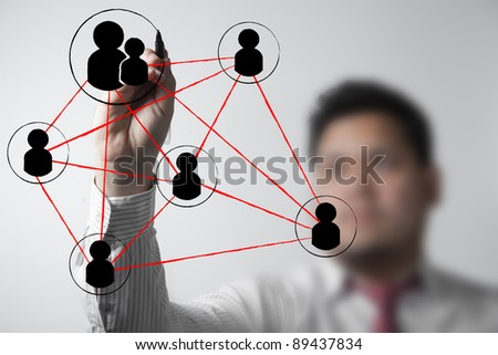 businessman drawing a social network scheme on a whiteboard - stock photo