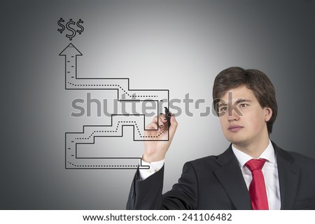 businessman drawing a way out of labyrinth - stock photo