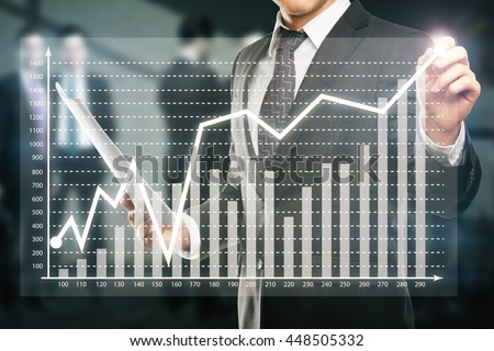 Businessman drawing abstract business chart on blurry background with other businesspeople - stock photo