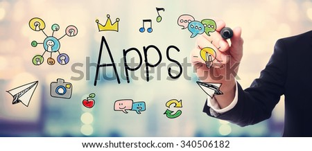 Businessman drawing APPS concept on blurred abstract background  - stock photo