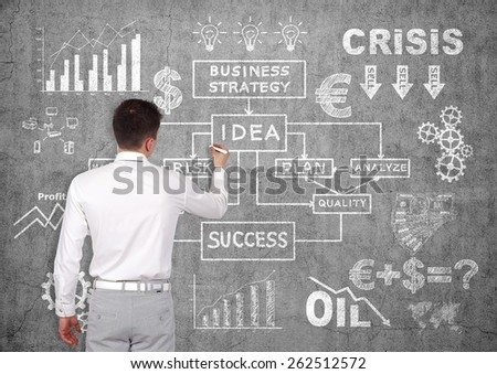 businessman drawing business concept on concrete wall - stock photo