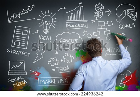 Businessman drawing business concept on wall for creativity, imagination and inspiration - stock photo