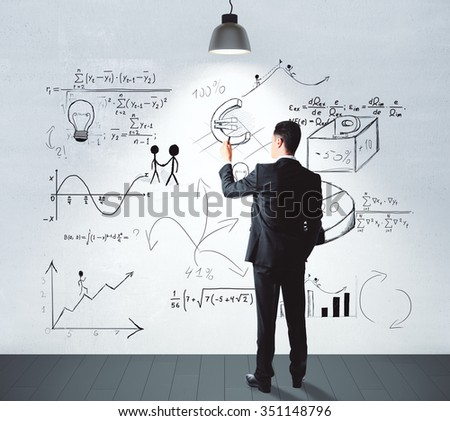 Businessman drawing business idea concept on white wall in empty room - stock photo