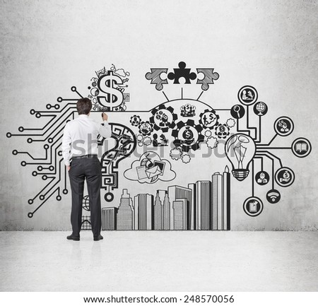 businessman drawing business strategy on wall - stock photo