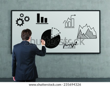 businessman drawing chart on a whiteboard - stock photo