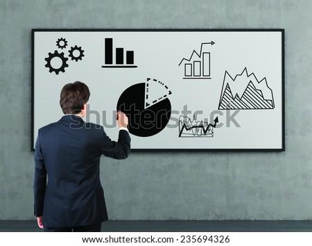 businessman drawing chart on blackboard - stock photo