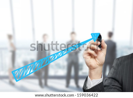 businessman drawing chart on office background - stock photo