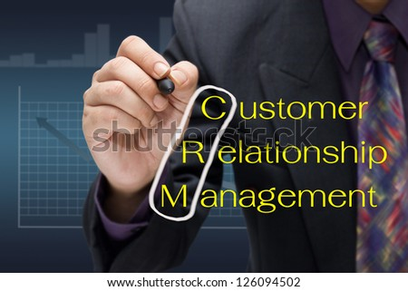 Businessman drawing circle on customer relationship management