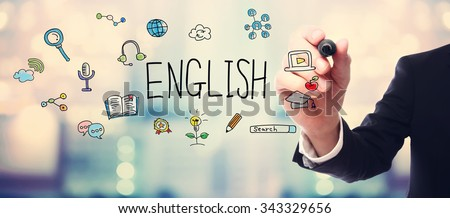Businessman drawing English concept on blurred abstract background  - stock photo