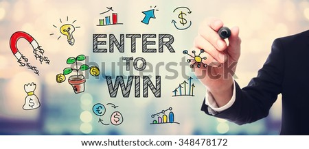Businessman drawing Enter to Win concept on blurred abstract background  - stock photo
