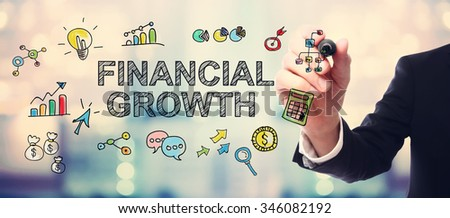 Businessman drawing Financial Growth concept on blurred abstract background  - stock photo