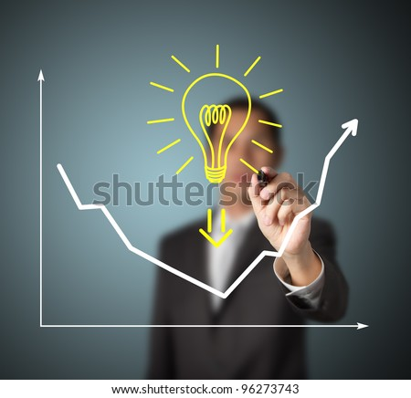 businessman drawing graph to show that big idea can change business trend from downward to upward - stock photo