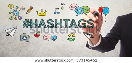Businessman drawing Hashtags concept with a marker - stock photo