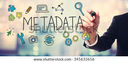 Businessman drawing Metadata concept on blurred abstract background  - stock photo