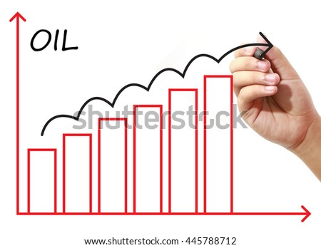 Businessman drawing OIL Graph on virtual screen. Business, banking, finance and investment concept. - stock photo
