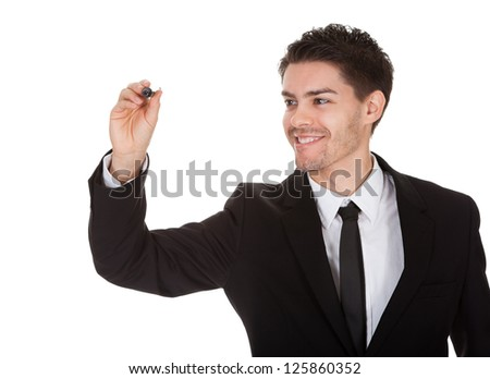 Businessman drawing on the screen. Isolated on white