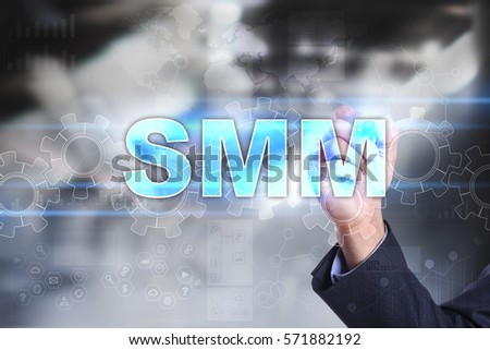 Businessman drawing on virtual screen. smm concept.