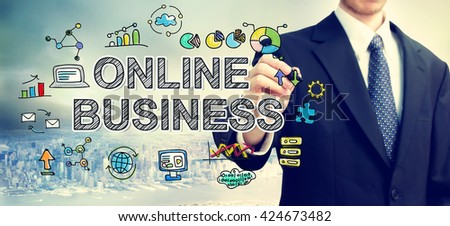 Businessman drawing Online Business concept above the city - stock photo