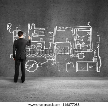 businessman drawing plan mechanism on wall