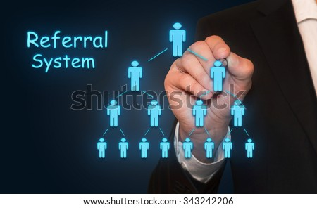 Businessman drawing Referral system concept, with neon , business concept - stock photo