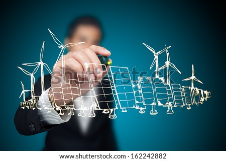 Businessman drawing renewable energy project. - stock photo