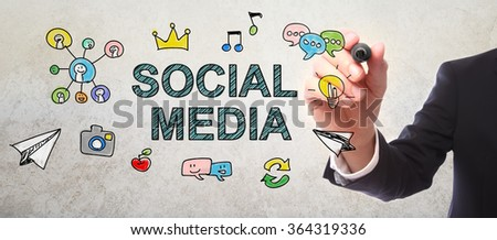 Businessman drawing Social Media concept with a marker - stock photo