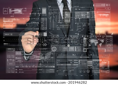 businessman drawing some graphs and sketches in the background is a city landscape - stock photo