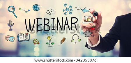 Businessman drawing Webinar concept on blurred abstract background