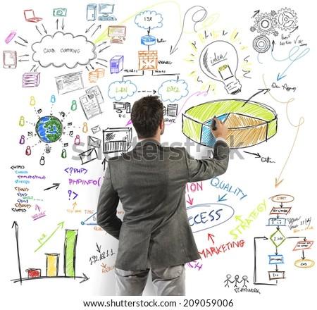 Businessman draws a big modern business project - stock photo