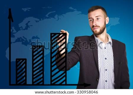 Businessman draws a graph - stock photo