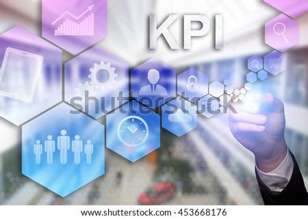 "Businessman draws ""KPI"" on the virtual screen. Business concept. Internet concept. - stock photo"