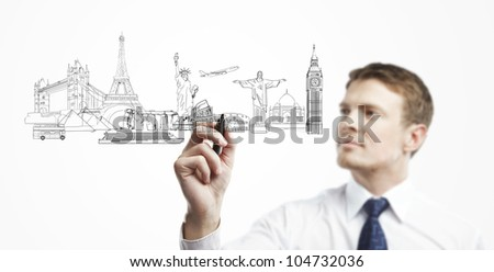 businessman draws outline a architectural buildings - stock photo
