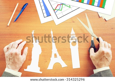 Businessman dreaming about big travel. Abstract conceptual image - stock photo