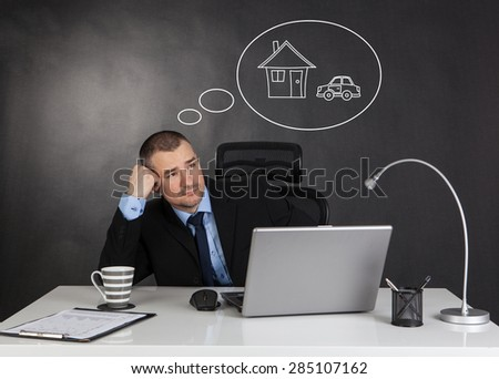 Businessman dreaming house and car - stock photo