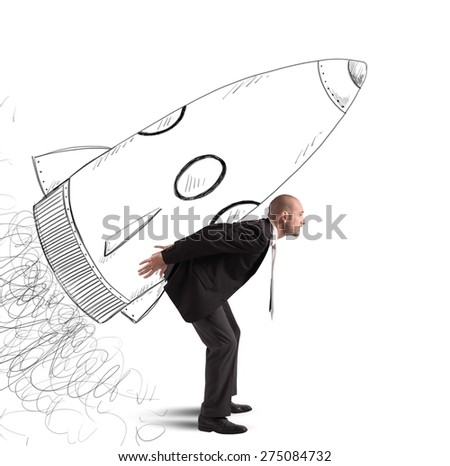 Businessman dreams to achieve success with spaceship - stock photo