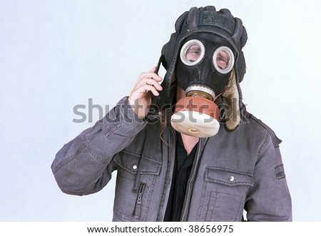 Businessman dress a gas mask, now inconveniently to speak on the phone.