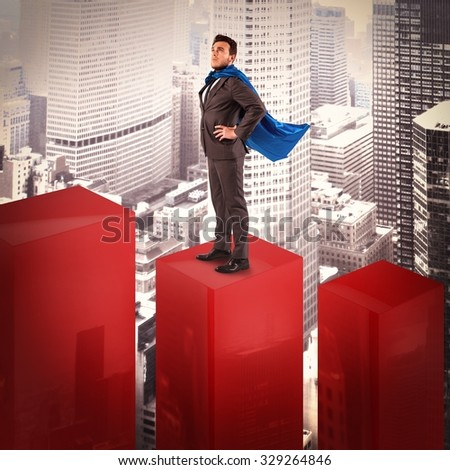 Businessman dressed as a hero on statistic - stock photo