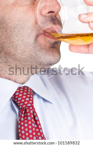 businessman drinking whisky - stock photo